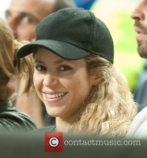 Shakira and Shakira - A pregnant Shakira and Gerard Pique attend the USA v Slovenia game at the Basketball World...