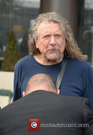 Robert Plant - Rocker Robert Plant literally let his hair down while leaving his Manchester hotel.  The Whole Lotta...