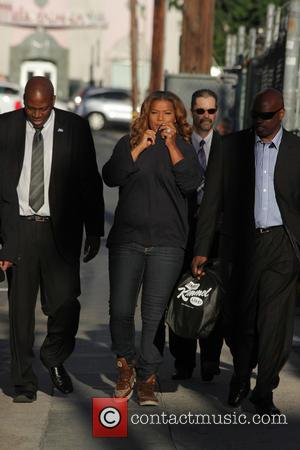 Queen Latifah - Queen Latifah covers her nose with her sweater as she arrives for her appearance on Jimmy Kimmel...