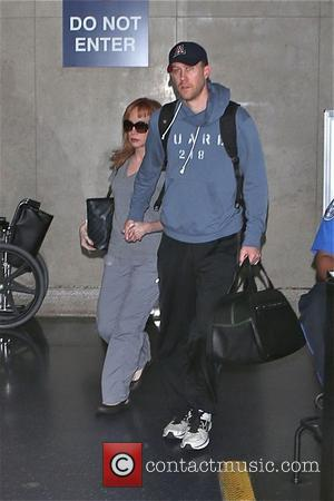 Kathy Griffin - Kathy Griffin and her boyfriend arrive at Los Angeles International Airport (LAX) - Los Angeles, California, United...