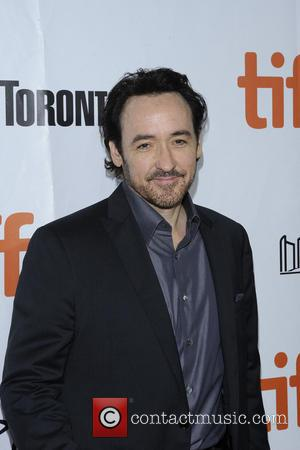 "John Cusack Brands Hollywood A ""Whorehouse"" Where ""People Go Mad"""