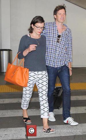 Milla Jovovich and Paul Anderson - Milla Jovovich and husband Paul Anderson at Los Angeles International Airport (LAX) - Los...