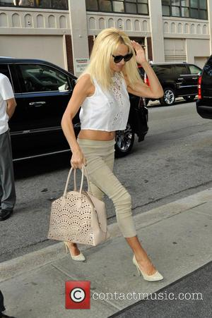 Pamela Anderson - Pamela Anderson returning to her hotel - Manhattan, New York, United States - Thursday 11th September 2014