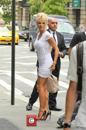 Pamela Anderson - Pamela Anderson returns to her hotel in New York City - Manhattan, New York, United States -...