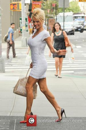 Pamela Anderson - Pamela Anderson returns to her hotel in New York City - Manhattan, New York, United States -...