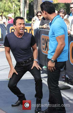 Bruno Tonioli and Mario Lopez - Celebrities appear on 'Extra' at Universal City Walk - Los Angeles, California, United States...