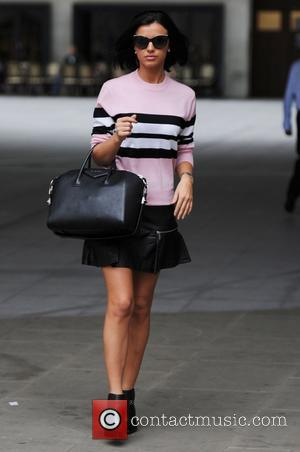 Ahead of the 'Tumble' final Lucy Mecklenburgh spotted at the BBC Radio 1 studios wearing a pink sweater and black...