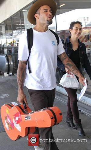 Ben Harper - Ben Harper and a female friend at Los Angeles International Airport (LAX) - Los Angeles, California, United...