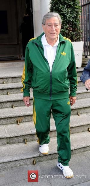 Tony Bennett - Tony Bennett seen leaving the Merrion Hotel wearing a green tracksuit and trainers. He is preforming this...
