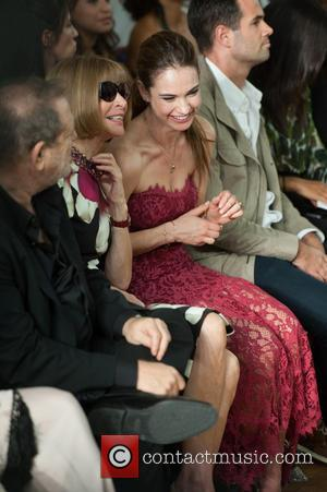 Lily James and Anna Wintour - London Fashion Week Spring/Summer 2015 - Marchesa - Front Row - London, United Kingdom...