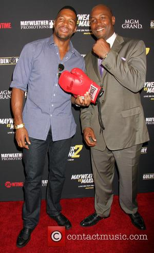 Michael Strahan and Lennox Lewis - Stars attend the pre-fight party ahead of the Mayhem: Mayweather vs. Maidana 2 fight...