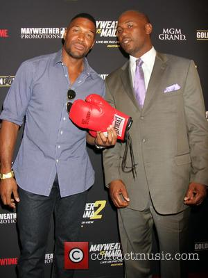 Michael Strahan and Lennox Lewis