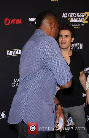 Michael Strahan and Paul Wesley