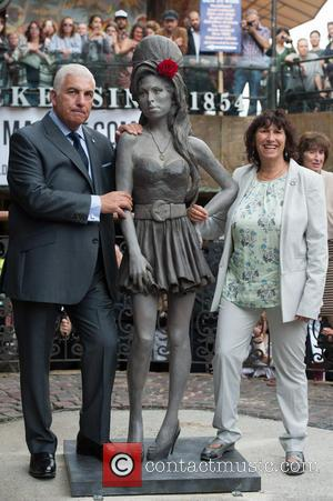 Mitch Winehouse and Janis Winehouse - Amy Winehouse statue unveiling held at Camden Market. - London, United Kingdom - Sunday...