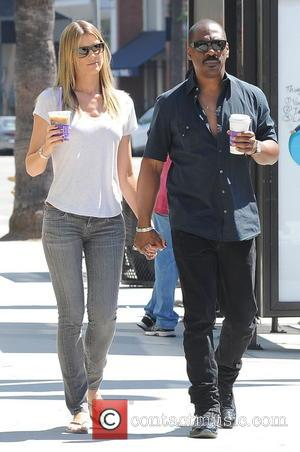 Eddie Murphy and Paige Butcher - Eddie Murphy and his girlfriend Paige Butcher walk hand and hand after picking up...