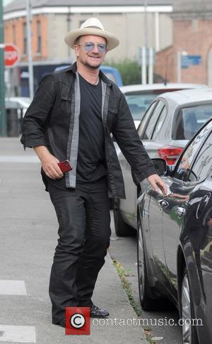 Bono - U2's Bono spotted walking to his car in Ballsbridge with what appears to be the new Apple iPhone...