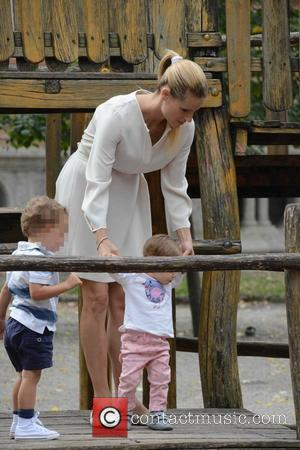 Michelle Hunziker and Sole Trussardi - Pregnant Michelle Hunziker plays with her daughter Sole at the park - Milan, Italy...