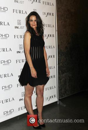 Katie Holmes - Katie Holmes makes an appearance to celebrate her cover on Dujour Magazine - New York, New York,...