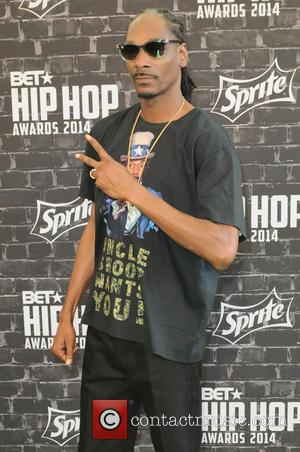 Snoop Lion and Snoop Dogg - A variety of hip hop stars were photographed as they arrived at the 2014...