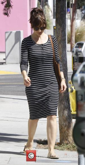 Minka Kelly - Minka Kelly out and about in a black and white stripped dress - Los Angeles, California, United...