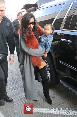 Kim Kardashian and North West - Kim Kardashian and baby daughter North West at LAX - Hollywood, California, United States...