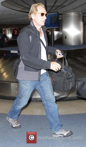 Julian Sands - Julian Sands arrives at Los Angeles International Airport - Los Angeles, California, United States - Tuesday 23rd...