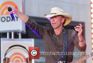 Kenny Chesney - American country music singer Kenny Chesney photographed performing on the TV show 'Today' in NY, New York,...