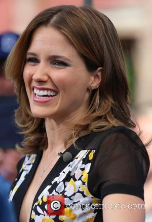 American actress Sophia Bush appears on Extra to promote TV Drama Chicago P.D. at Universal Studios wearing a dress with...