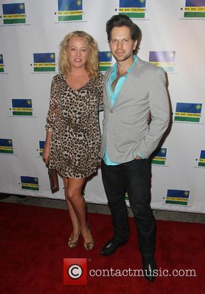 Virginia Madsen and Nick Holmes