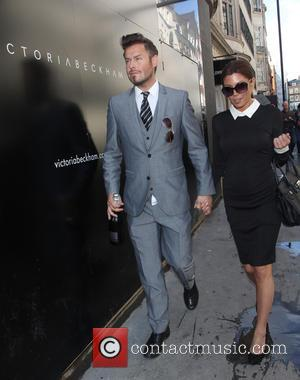 Victoria Beckham LOOKALIKE and David Beckham LOOKALIKE - Victoria and David Beckham lookalikes on Dover street - London, United Kingdom...