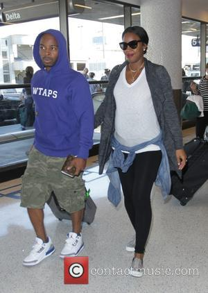 Kelly Rowland and Tim Witherspoon - EXCLUSIVE Pregnant Kelly Rowland arrives at Los Angeles International Airport (LAX) with her husband...
