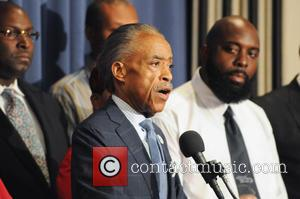 Al Sharpton and Michael Brown Sr - Civil rights leaders join the families of Michael Brown and Eric Garner the...