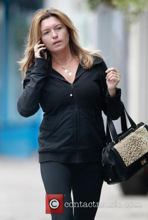 Tina Hobley - A make-up free Tina Hobley, looks tired as she chats on her phone whilst out and about...