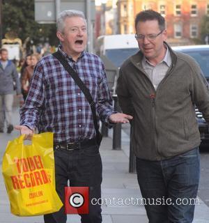 Louis Walsh and Derek Mooney - Louis Walsh seen walking around Dublin with friend, RTE radio presenter Derek Mooney. -...