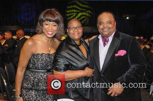 Roland Martin and Melanie Campbell