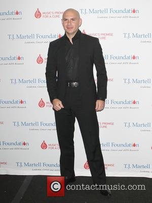 PITBULL - Stars were photographed as they arrived at the 15th Annual T.J. Martell Foundation Family Day in New York...