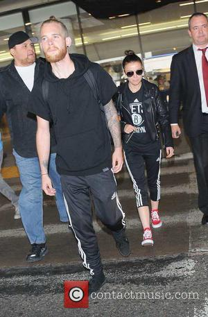 Cher Lloyd and Craig Monk - Cher Lloyd arriving at Los Angeles International Airport - Los Angeles, California, United States...