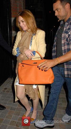 Lindsay Lohan Pops Gold Dust After West End Opening Night