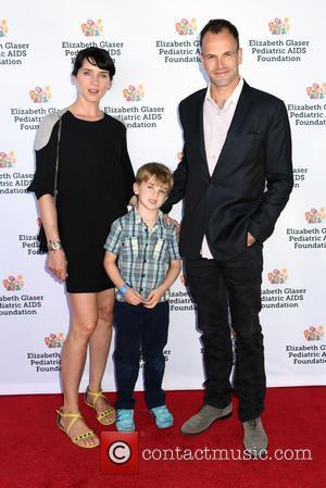 Jonny Lee Miller, Michele Hicks and Buster Timothy Miller - Kids 4 Kids Elisabeth Glaser Event at Chelsea Pier -...