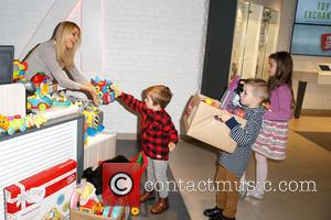 Tess Daly, Roman, Sebastian and Megan - Tess Daly attends a photocall to launch Argos Toy Exchange with Barnardo's at...