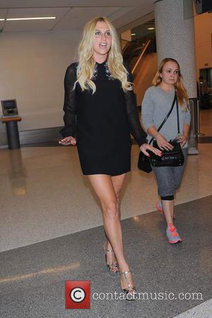 American singer, songwriter and rapper Kesha spotted as she arrives at Los Angeles International Airport wearing a black, long sleeve,...