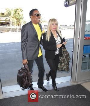 Charlie Wilson and Mahin Wilson - Charlie Wilson leaves Los Angeles International Airport - Los Angeles, California, United States -...