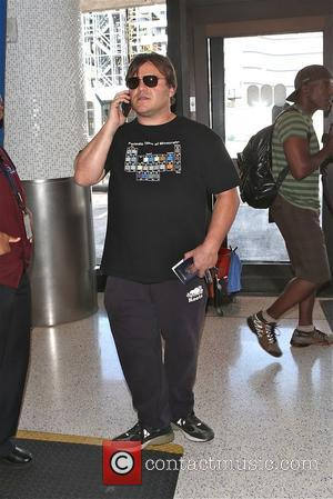 Jack Black - Jack Black pretends to be on phone like paris hilton - Los Angeles, California, United States -...
