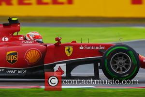 Kimi Räikkönen and (RAIKKONEN) - Shots from the F1 Japanese Grand Prix in Suzuka, Japan - Sunday 5th October 2014