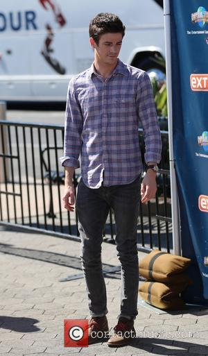 Grant Gustin - Tom Cavanagh and Grant Gustin from 'The Flash' appear on 'Extra' at Universal Studios - Los Angeles,...