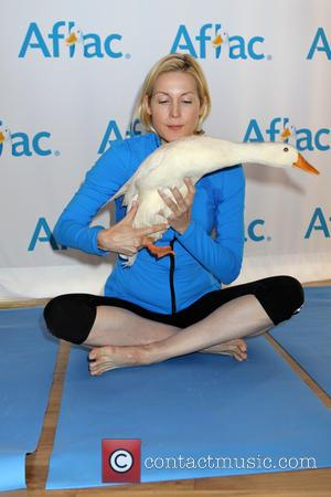 Kelly Rutherford and Aflec Duck - Yoga with the Aflec Duck - New York, New York, United States - Thursday...