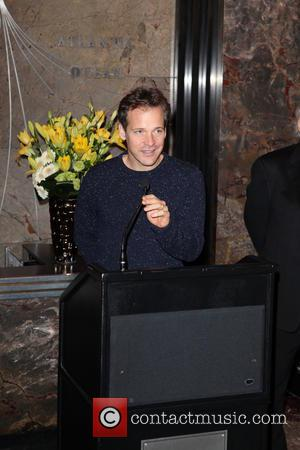 Peter Sarsgaard - Peter Sarsgaard lights up The Empire State Building - New York City, New York, United States -...