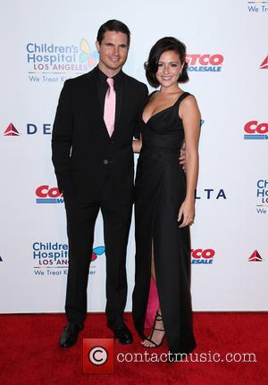 Robbie Amell and Italia Ricci