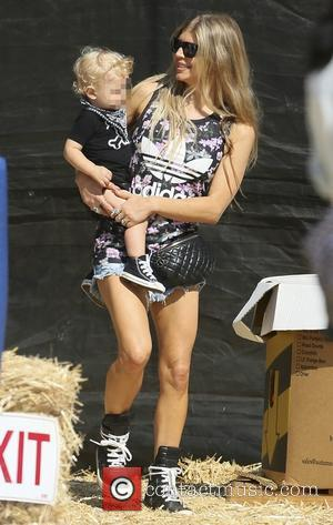 Fergie and Axel Duhamel - American singer songwriter and vocalist for The Black Eyed Peas Fergie with husband Josh Duhamel...