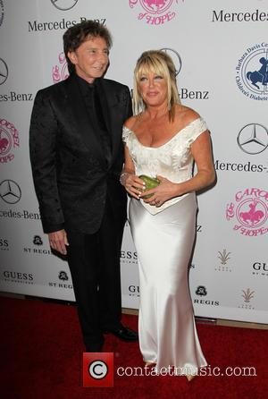 Barry Manilow and Suzanne Somers - A host of celebrities took to the red carpet and were photographed at the...